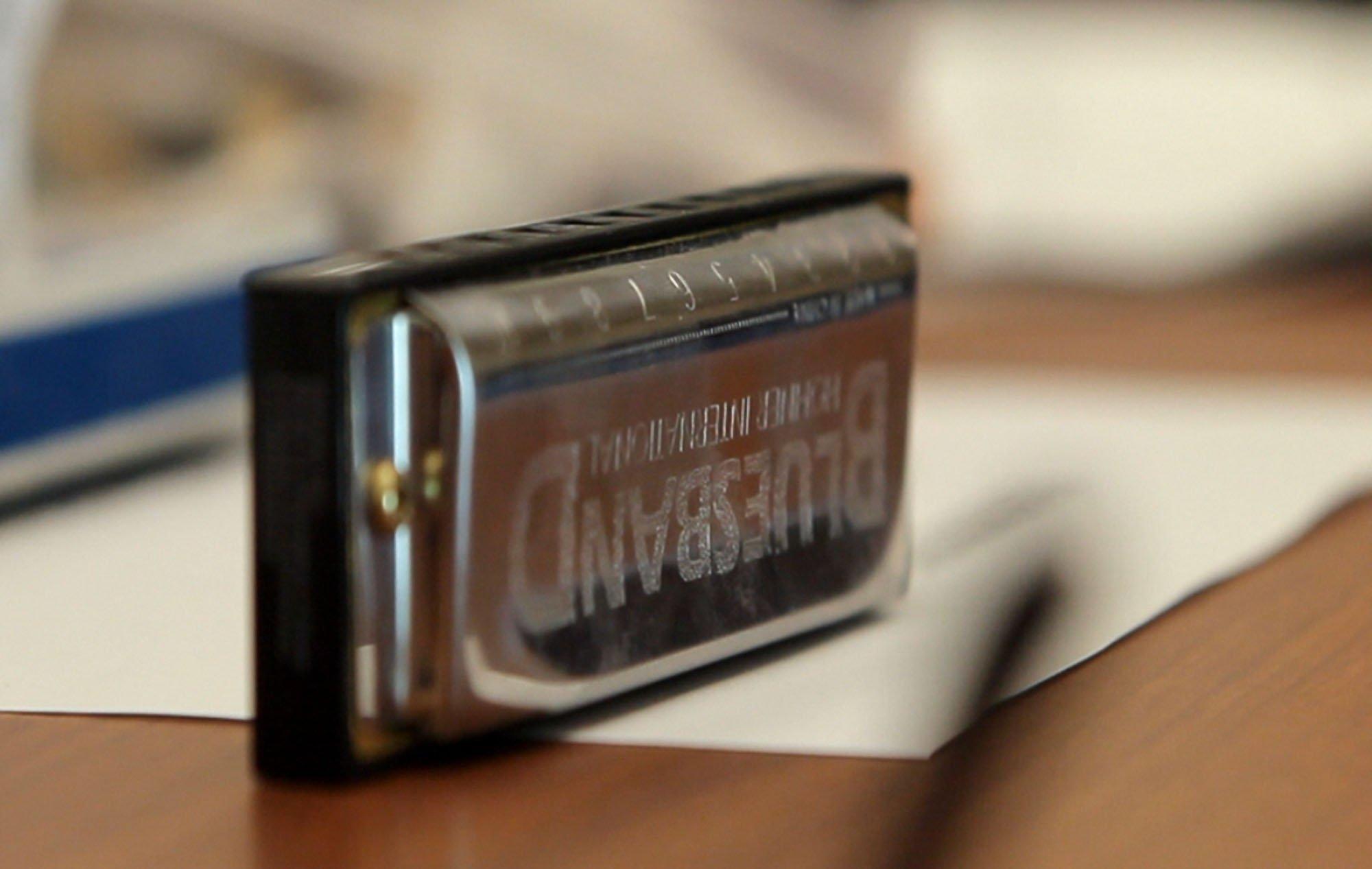 a harmonica lies on a table