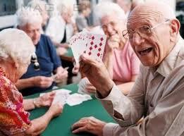 Group of senior citizens enjoying a card game