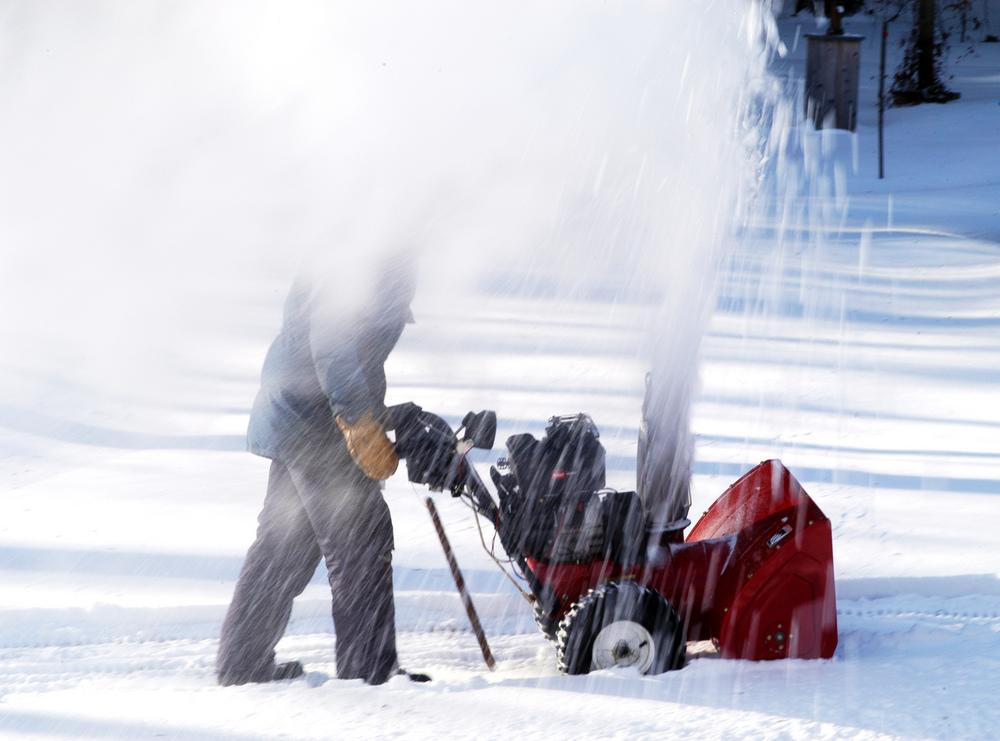 Man snowblowing