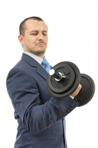 Man in suit lifting weights.