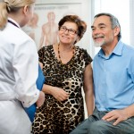 Older couple visiting physician