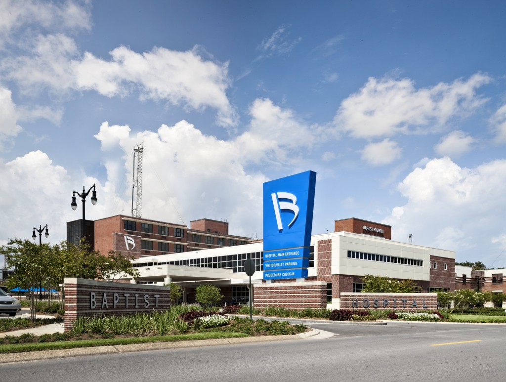 Main entrance Baptist Health Care campus with blue sky in the background