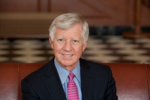Mr. Bill George, a member of the Mayo Clinic Board of Trustees in jacket, blue shirt and red tie