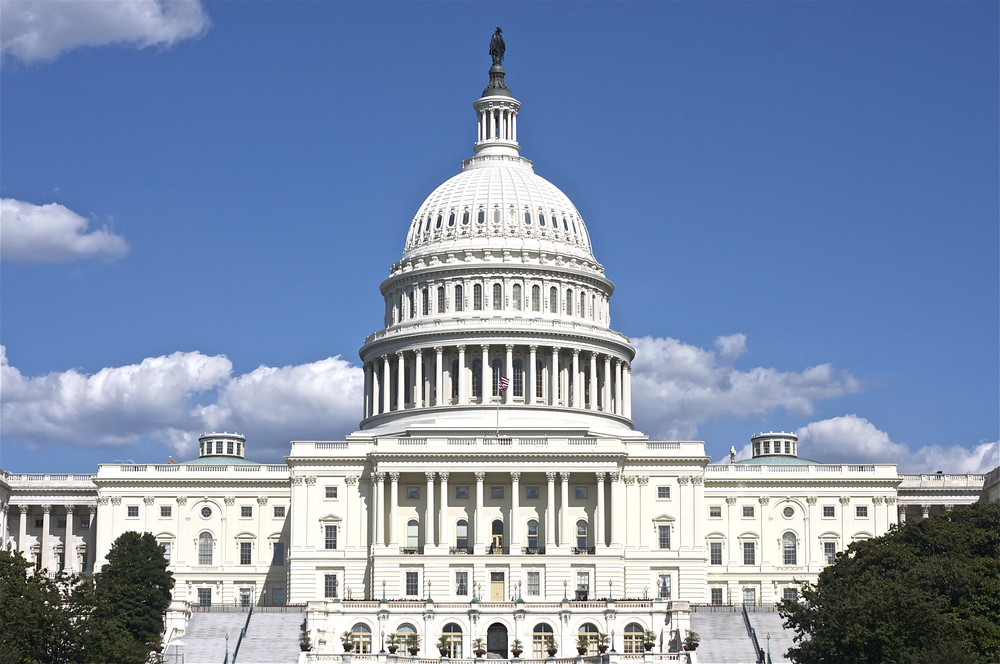 United States Capitol building in Washington DC with blue sky in the background