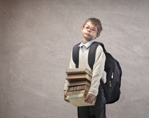 Boy with a heavy backpack