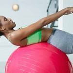 woman using exercise ball