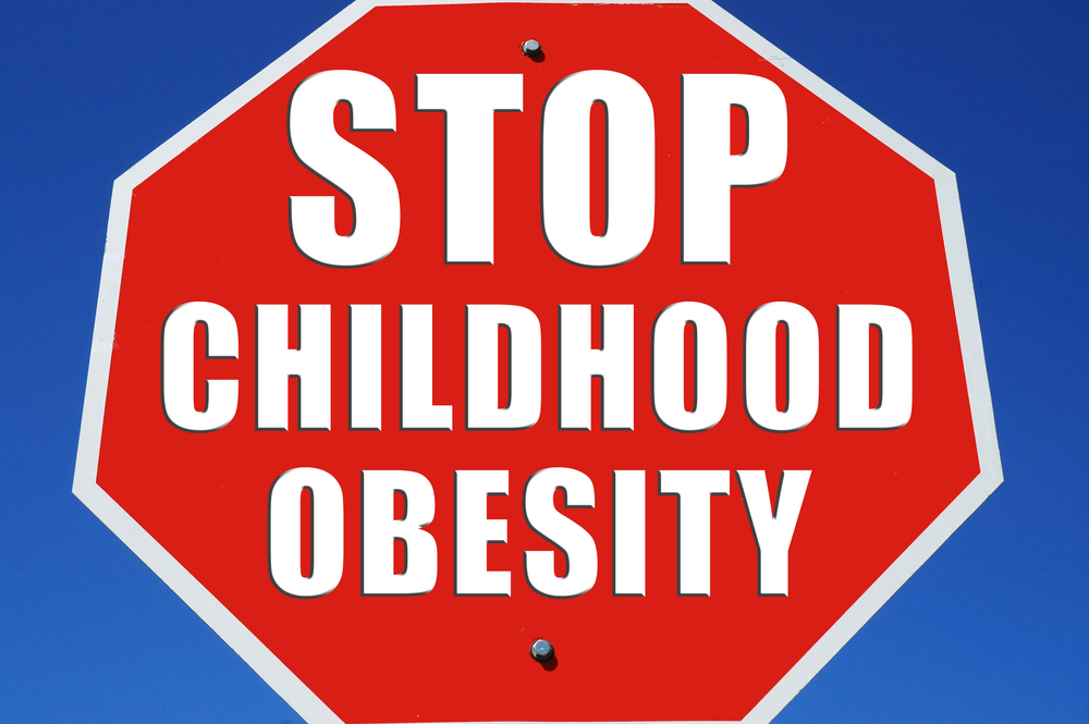 red and white stop sign with the words, STOP CHILDHOOD OBESITY