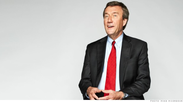 Medium shot of Dr. Noseworthy in dark suit with red tie and white background