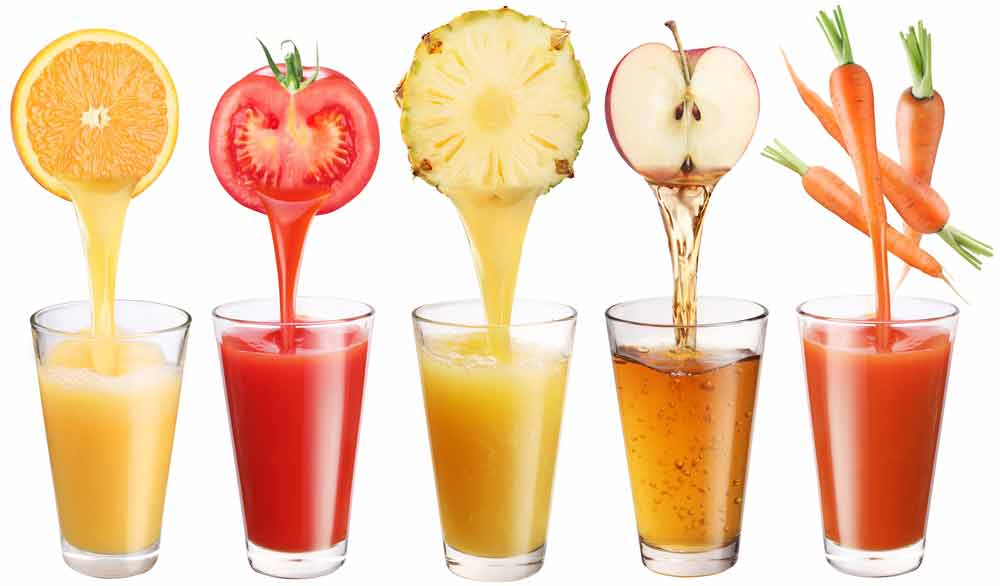 Five clear glasses filled with different juices and the fruit or vegetable about the glassed pouring in the juice