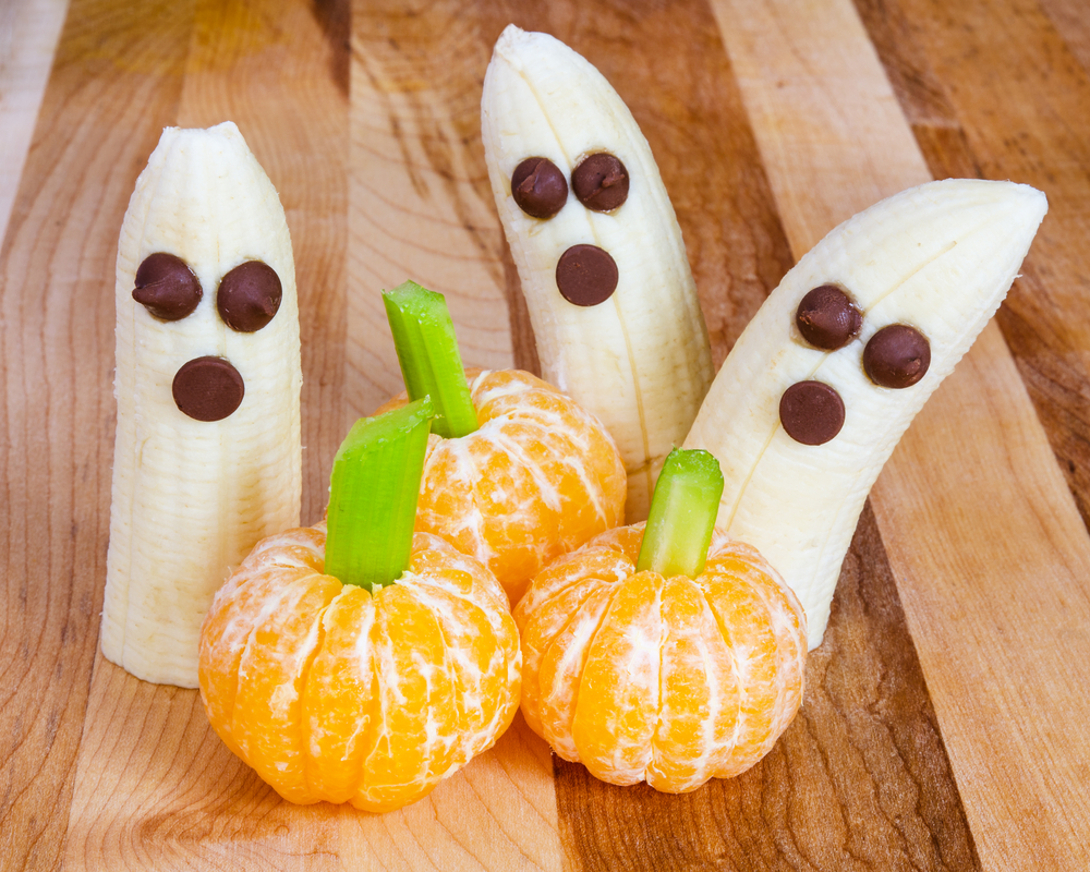 Halloween treats - bananas with chocolate chips, clementines with celery sticks