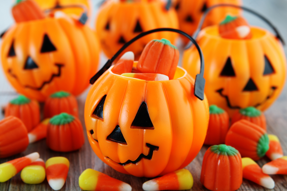 Trick or treat pumpkin buckets with yellow and orange candy corn
