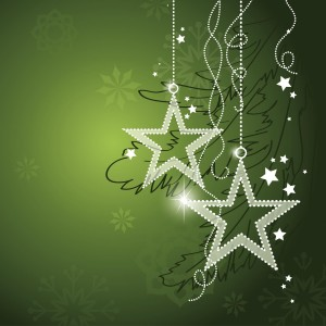 White sparkling star ornaments on silver strings with dark green background