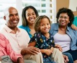 Feature multigenerational African American family sitting on couch
