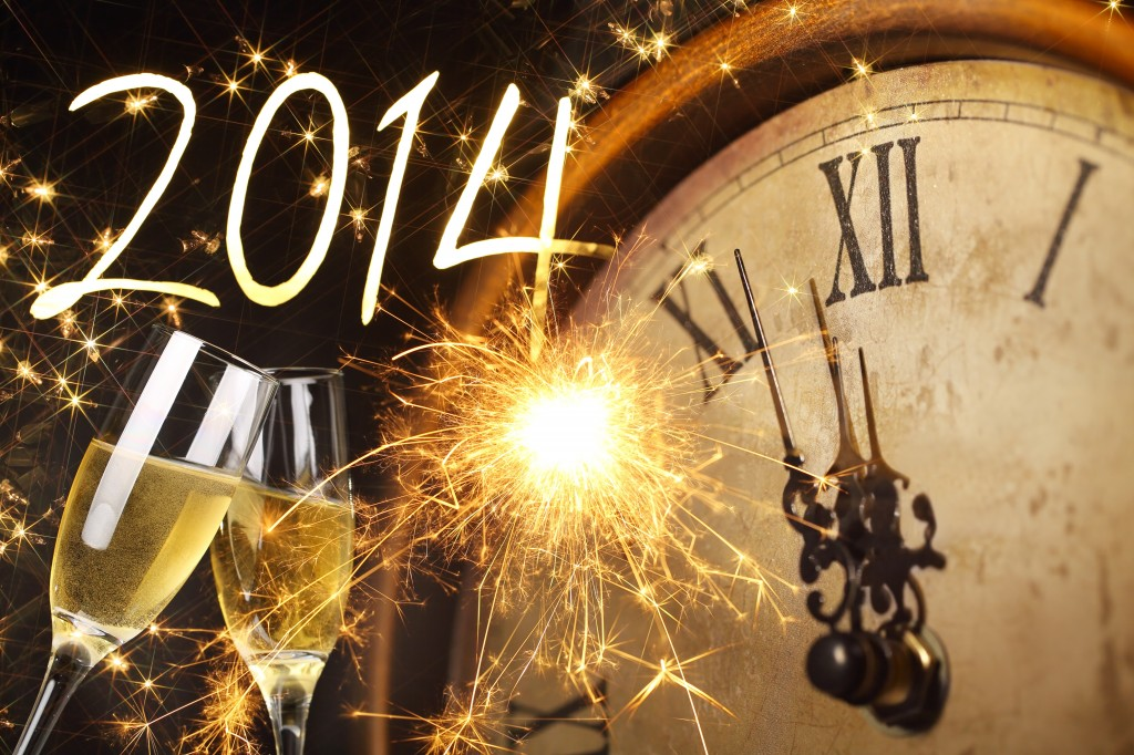 2014 New Year's clock with sparklers and glasses of champagne