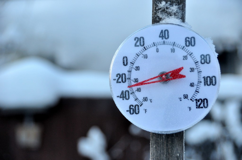 Outdoor winter thermometer showing -30 degrees