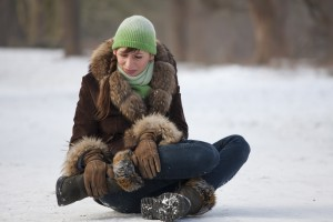 Woman hurts leg in winter fall on snow and ice