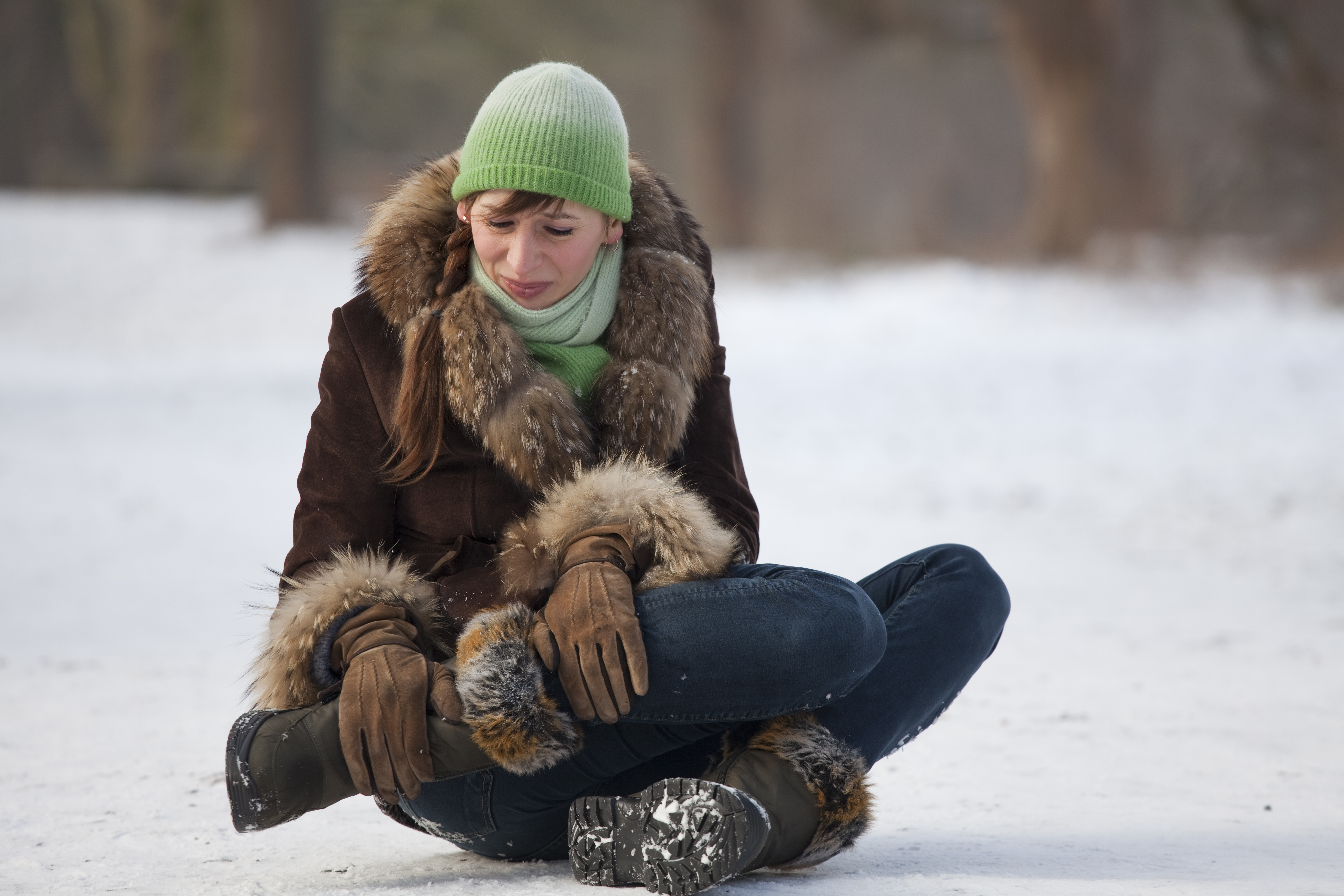 Woman hurts leg in winter fall