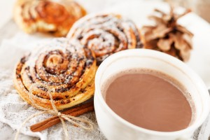 Warm winter food with sweet rolls and hot cocoa