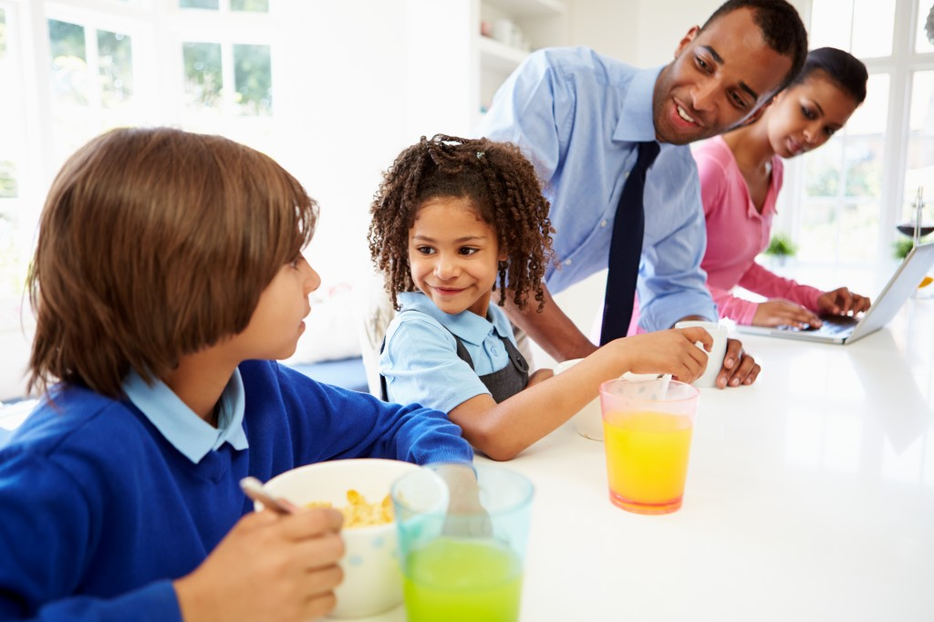 Family breakfast meal with juice and cereal