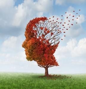 Concepto de la mente humana con hojas desprendiéndose de un árbol