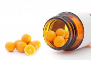 Prescription bottle with oranges as vitamin C tablets