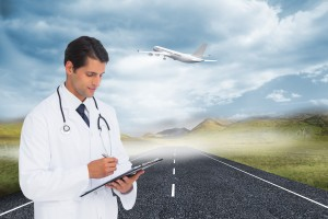 Doctor writing on clipboard with airplane taking off in background