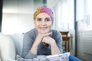 Woman cancer survivor with scarf on her head after chemo