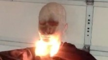 mannequin with bottom portion of the face in flames