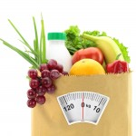 Grocery bag with healthy foods and weight scale