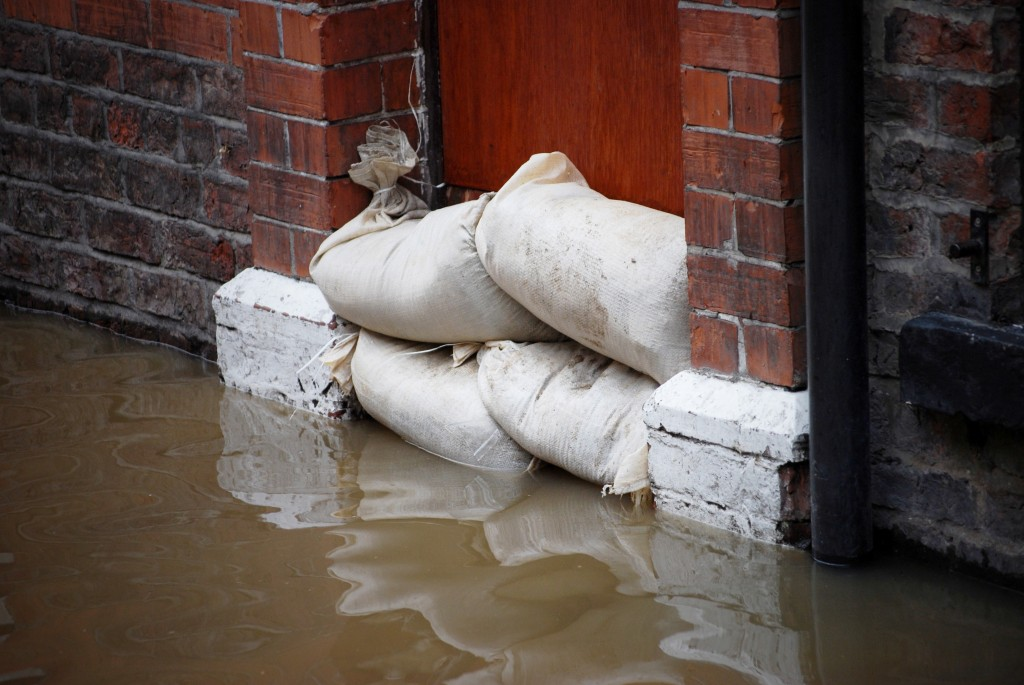 standing water after flood with sandbags in doorway -possibly breeding infectious diseases