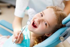 Little girl in chair for dental exam