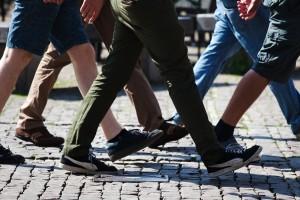 several men walking on brick road