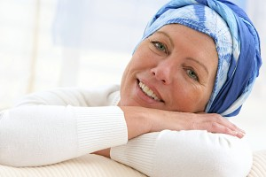 woman with headscarf after chemotherapy and cancer treatment