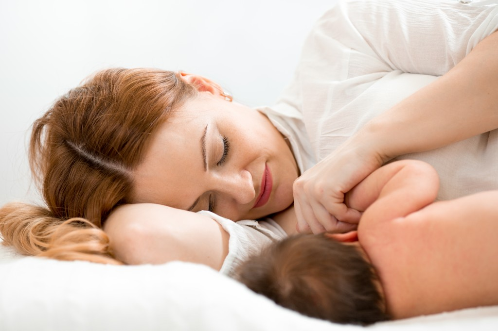 Woman nursing or breastfeeding baby