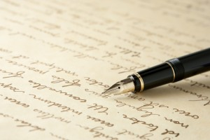 Lost art of letterwriting - closeup of paper and ink pen