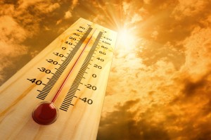 thermometer pointing up toward bright sunshine