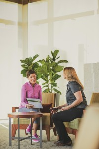 Wellness coach talking to patient