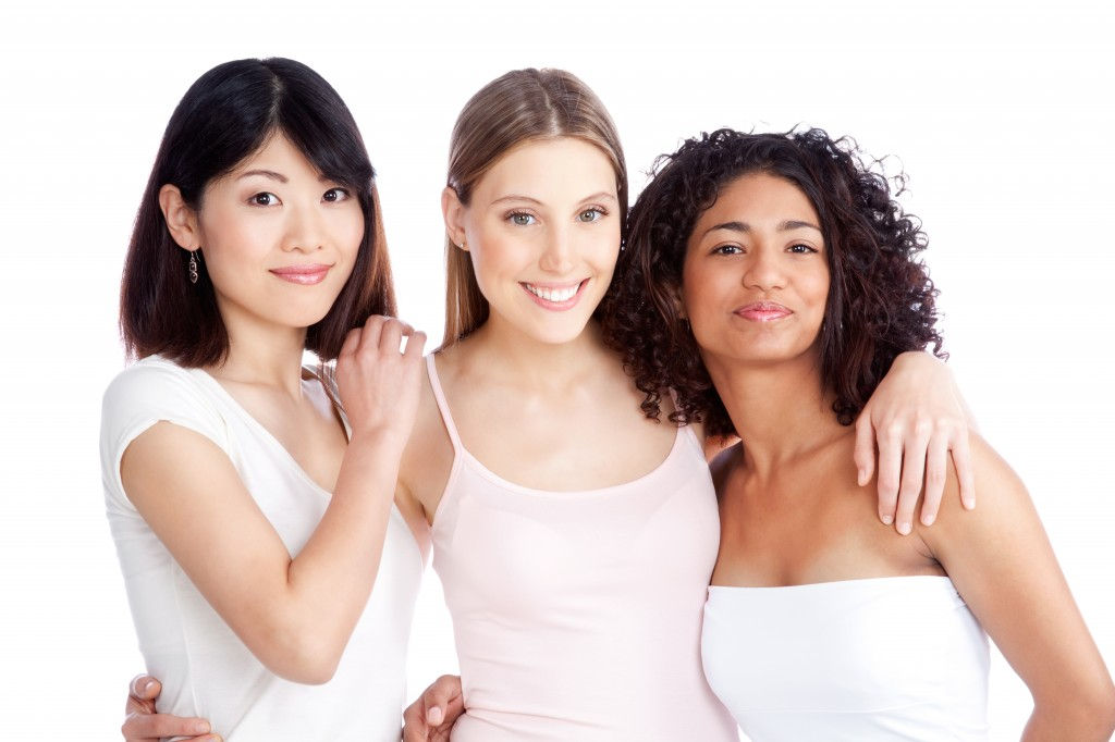 three young healthy looking women of diversity