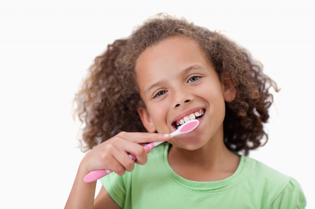 young African-American girl brushing her teeth