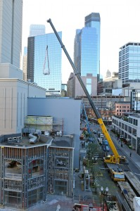 Crane delivering new MRI to Mayo Clinic Square in downtown Minneapolis.