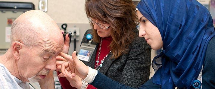 medical team examining older patient