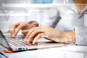 social media image of person typing with hands on computer keyboard