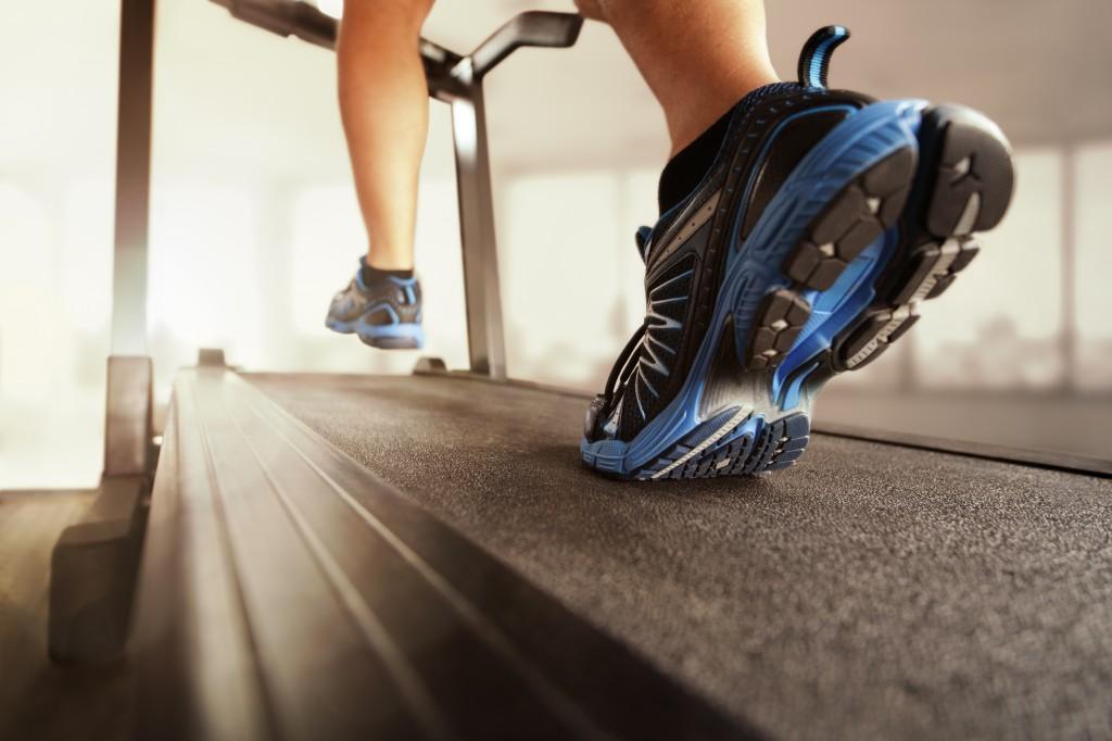 Feet running on a treadmill