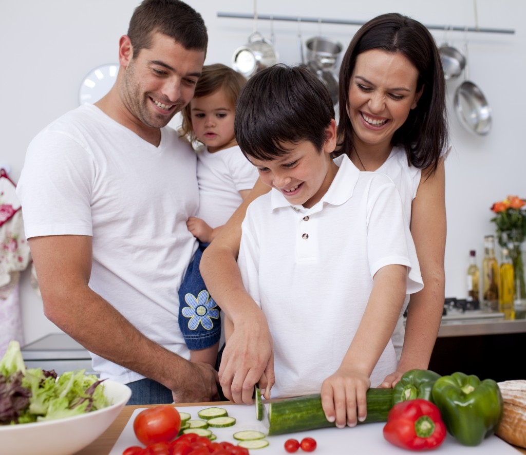 family preparing healthy meal in the kitchen
