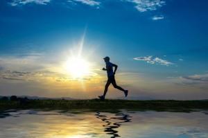 man running near lake for exercise
