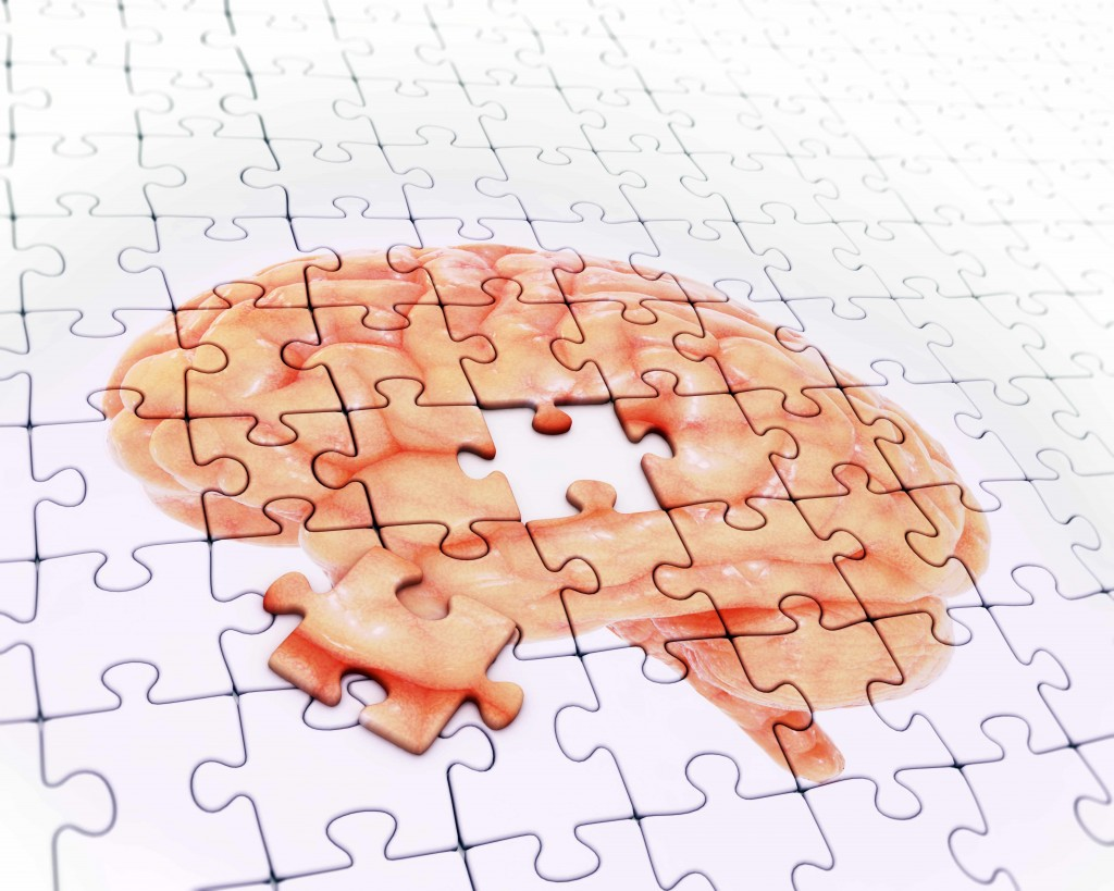 puzzle with illustration of brain and one piece missing representing memory loss, dementia, MCI, Alzheimer's