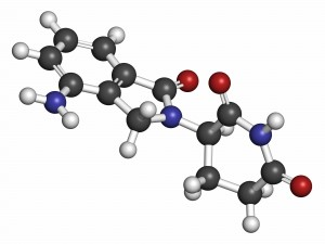Lenalidomide multiple myeloma drug molecule. Atoms are represented as spheres with conventional color coding: hydrogen (white), carbon (grey), oxygen (red), nitrogen (blue).