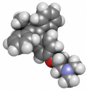 Tamoxifen breast cancer drug, chemical structure. Atoms are represented as spheres with conventional color coding: hydrogen (white), carbon (grey), oxygen (red), nitrogen (blue)