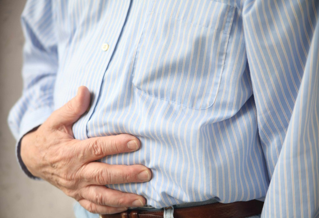 person with stomach ache or indigestion pain