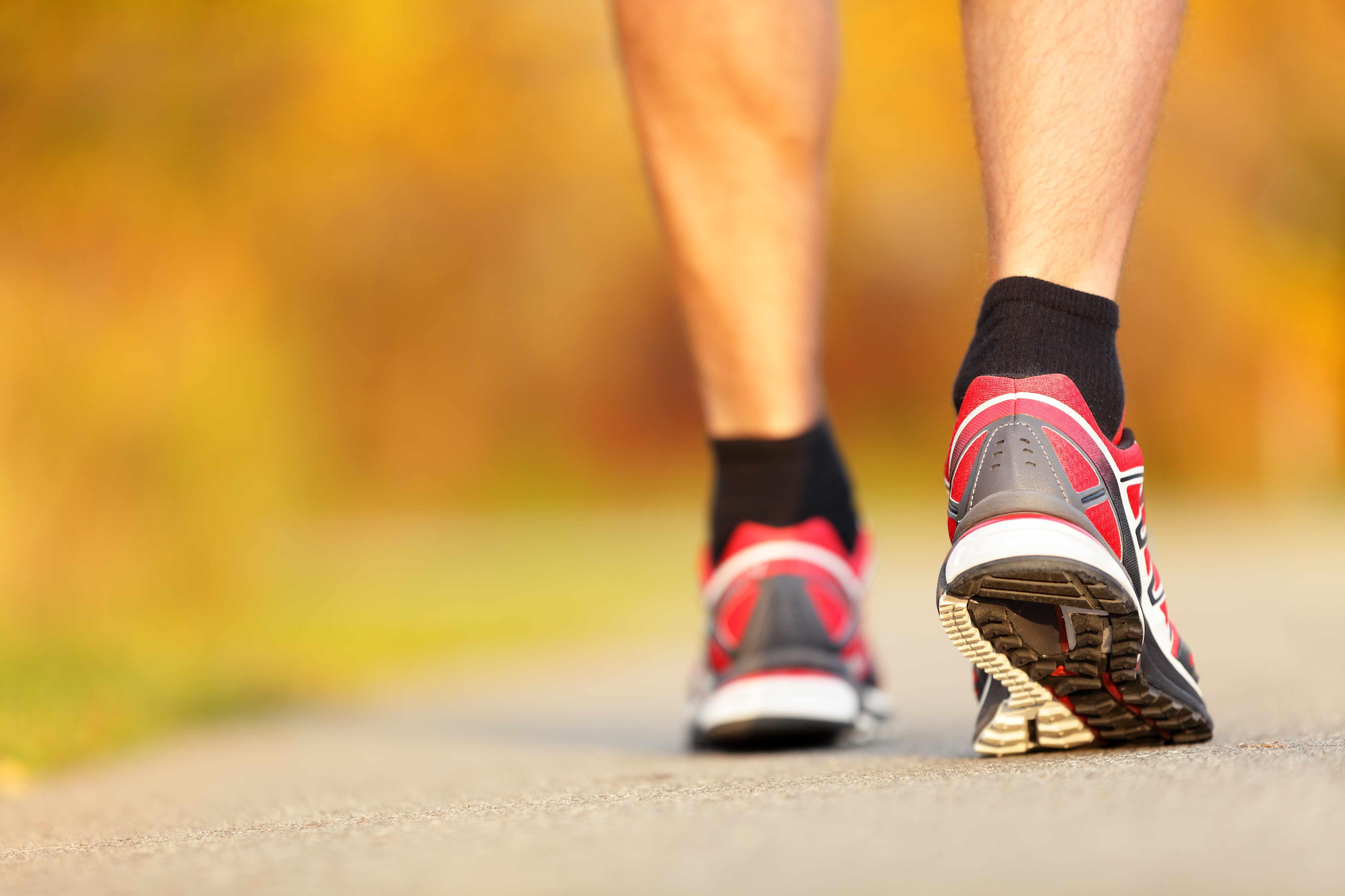Closeup of male running or walking